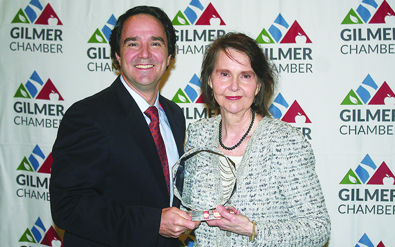 Merle Howell Naylor, right, holds the Gilmer Chamber's Citizen of the Year Award for 2019 alongside 2018 COTY Steve Purvis.