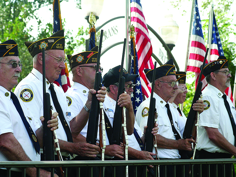 Members of the North Georgia Honor Guard are pictured preparing to fire a three-volley rifle salute during a past event at the Veterans Memorial Bridge and Garden in Ellijay.