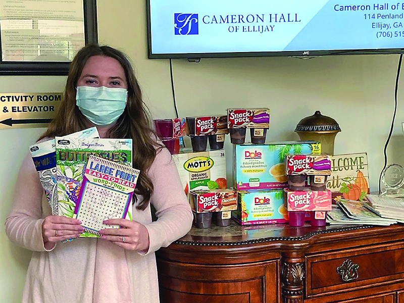 Macy Dotson, of Cameron Hall Assisted Living, is pictured with some of the items that have been donated for a holiday gift drive for local homebound senior citizens.