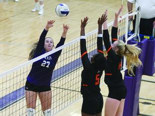 Gilmer's Lauren Smith tips the ball over the net and had 10 kills and 19 digs at Saturday's Raider Rally.