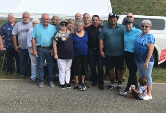 Principal Chief Richard Sneed (fifth from right, black polo shirt) visited with well-wishers in Cherokee County on Election Day for the Eastern Band of Cherokee Indians on Thursday in Marble.
