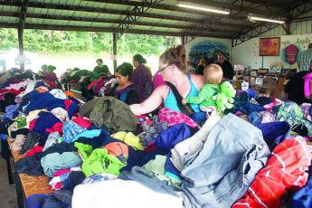 Customers will be able to fill a grocery bag of children's or adult clothes for $4 at the upcoming flea market presented by Ellijay Good Samaritan Catholic Church.
