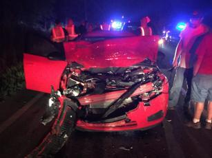 The 2014 Chevrolet Cruze driven by Robert Barrett is shown the night of the wreck on Highway 382 on July 11, 2015. Richard Joseph Burnette left a Ford Ranger pickup abandoned in the roadway without lights or emergency signals, according to documents.