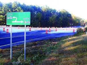 A sign marks new U-turn lanes near the intersection of Antioch Church Road and Highway 515 just south of the Gilmer/Pickens County line.