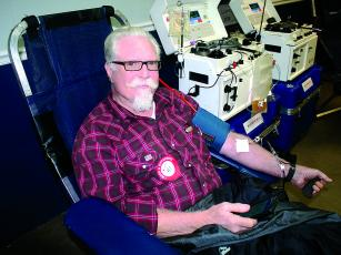 Ernie Russell waits patiently while donating double red blood cells at the last Northeast Georgia Red Cross blood drive to be held at the Ellijay Lions Club this decade.