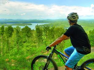 Mountain biker AJ Petrillo takes in a panoramic view of Lake Blue Ridge from one of the Aska trails.