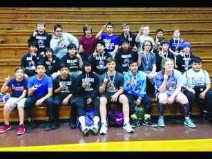 Above are Clear Creek wrestlers after winning the Mountain League's traditional wrestling title last Saturday. A day prior, the CCMS also won the league duals championship.