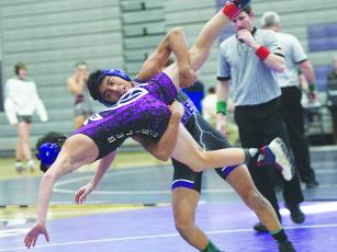Gilmer's Walter Lopez takes his Lumpkin County opponent to the mat at last Tuesday's Bobcats Duals.