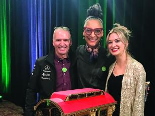 Julia Vorpahl, a 2014 Gilmer High School grad, right, and her dad, Larry, are joined by Food Network personality and professional chef Carla Hall, center, at the 2019 National Gingerbread House Competition in Asheville, N.C.
