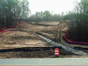 Pictured is a swath cut through wooded land off Old Highway 5 that will be used in the forthcoming connection of Highways 382 and 515. The Georgia Department of Transportation highway extension project is expected to last into 2021.