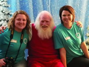Santa (Jack Senterfitt) will team up with local photographers Haley Vick, left, and Gena Farmer, right, for an upcoming Sensory Santa event at Clear Creek Elementary School. Anyone who has children with special sensory needs can make an appointment for a Santa visit and photo session.