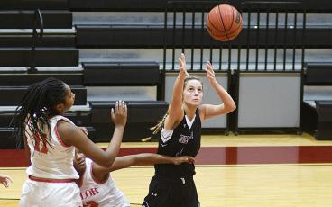 Lady Cat Elly Callihan tracks down a rebound and was Gilmer's top scorer versus Heritage (17 points) and Ridgeland (27) last week.