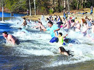 Black Bear Plunge participants hit the lake at Fort Mountain State Park New Year's Day. Air temperature was around 35, and the water was 52 degrees, a ranger announced.