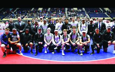 Above are Gilmer High School wrestlers and coaches following the Bobcats' second-place finish in the Class 4A state duals.