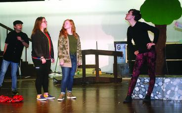 From left, Raegan Dempsey, as Winnie the Pooh, and Sophie Burnette, as Piglet, meet Tigger, Nick Jones, during a rehearsal for the upcoming GHS Theatre production of The House at Pooh Corner.