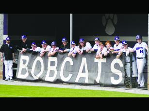 The Bobcat bench looks on during a Gilmer at-bat earlier this season. The GHS varsity has posted a 2-4 record and has three more games scheduled for this week.