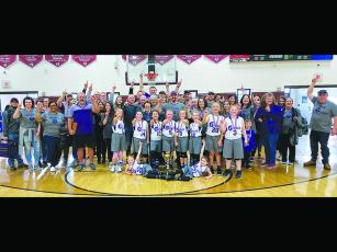 Joining 8-under all-star basketball coaches Ashley Phillips and Brady West and fans are the Class C state champion Gilmer Lady Cats. Front row, from left are Kensie Farmer and  Ally Phillips. Back row, are Roxy McVey, Brenlee Daniel, Halle Mae West, Alayna Martin, Kensey Pritchett, Lola Howard, Rose Everett and Mattie Jones.