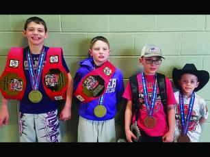 "The Georgia Kids State Championship was held last weekend, and four Gilmer Bobcat Club wrestlers earned medals in the ""little kids"" division. From left, are state champions Isaiah Goodwin and Parker Settel, fifth-place finisher Keigan Brookshire and third-place finisher Dawson Duncan."