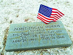 The gravesite of James Logan Morris at Liberty Baptist Church, killed in Vietnam 12 days before his 23 birthday.