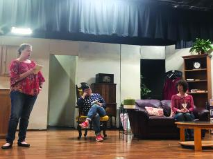 From left, cast members Annette Busateri, Martha Heffner and Nancy Sauls rehearse a scene for Exit Laughing in March. The community theater production that was originally set to run March 27-April 5 will be rescheduled for next year.
