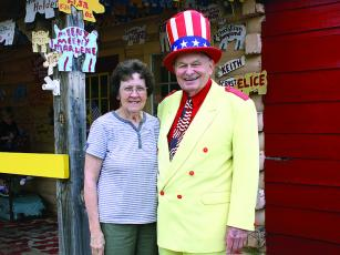 Oscar and Edna Poole are pictured in front of their East Ellijay family business Poole's BBQ. Oscar Poole sports the yellow suit and red, white and blue accessories that brought him attention in the worlds of food and politics.