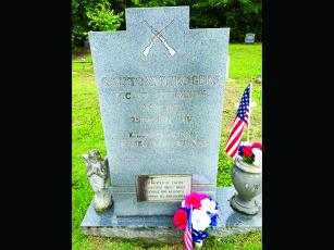 "The headstone of Clarance W. 'Tommy' Rogers at Varnell Cemetery in north Whitfield county, killed in Vietnam on June 16, 1967. An inscription reads, ""Sacrifices of every generation make more precious the heritage we have as Americans."
