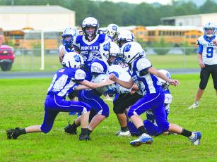 The Clear Creek seventh-grade Bobcats rally to make a gang tackle versus Fannin County last Thursday.