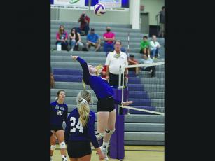 Gilmer's Taylor McCormick plays a ball at the net and tallied 10 kills for the Lady Cats last week