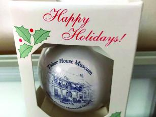 A Christmas ornament available this year shows downtown Ellijay's historic Tabor House Museum.