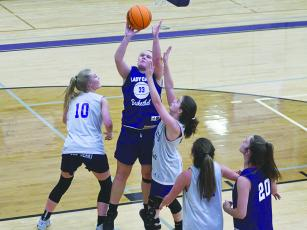 Lucy Ray scores two points in the post for Purple during last week's scrimmage.