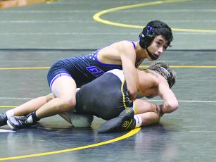 Gilmer Bobcat wrestler Arturo Gonzalez secured a win for GHS last Saturday as the Bobcats qualified for the Class 3A state duals.
