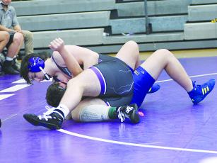 Gilmer High School junior Dylan Galloway is moments away from pinning his Etowah opponent last  Saturday.