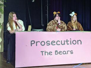 From left, Olivia Shull, Rachel Ballew and Cloie Burnell rehearse a scene for the upcoming Gilmer High School Theater production, Goldilocks On Trial.