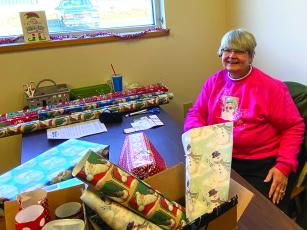 Melinda Cowan, above, and Janice Ross, below, were among those who volunteered to wrap gifts for this year's Gilmer Toys for Tots campaign, which distributed toys to local families up till Christmas Eve.