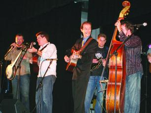 A string of 2008 and 2009 concerts paired guitarist Tony Rice (in suit) with the group Mountain Heart, featuring Barry Abernathy on banjo, at venues including the Grand Ole Opry, above, and the Ellijay Elementary School Auditorium, below.