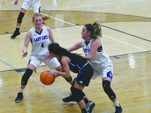 Hope Colwell (4) and Beth Burnette guard the perimeter.