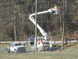 A crew is pictured working along South Main Street, part of the work area for an ongoing Georgia Power Grid Investment project that involves undergrounding and strengthening overhead power lines.