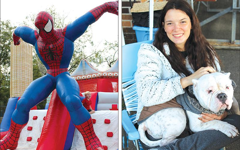 Left, Henry Cavataio, 4, of Roswell, makes sure his mom Laura is close by as he plays around a gigantic Spiderman at the kids' section of the Apple Festival. Right, Abbey, a representative of the Cherokee Humane Society, is held at the Apple Festival by Alyssa Goodwin, of Blue Ridge.