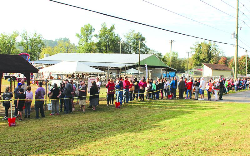 Well over 100 people line up Saturday morning at just one gate to get into the Apple Festival. Times for the final weekend are 9 a.m.-6 p.m. on Saturday, and 9 a.m.-5 p.m. on Sunday. Admission is $5 for adults, and free for children 10 and under.
