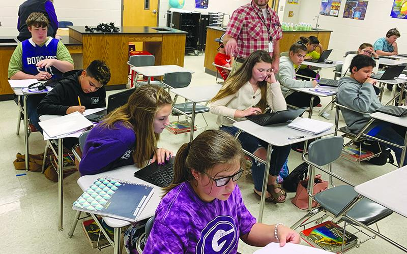 Clear Creek Middle School students in Les McDaniel's sixth-grade science class make use of their Chromebooks during Monday's lesson.