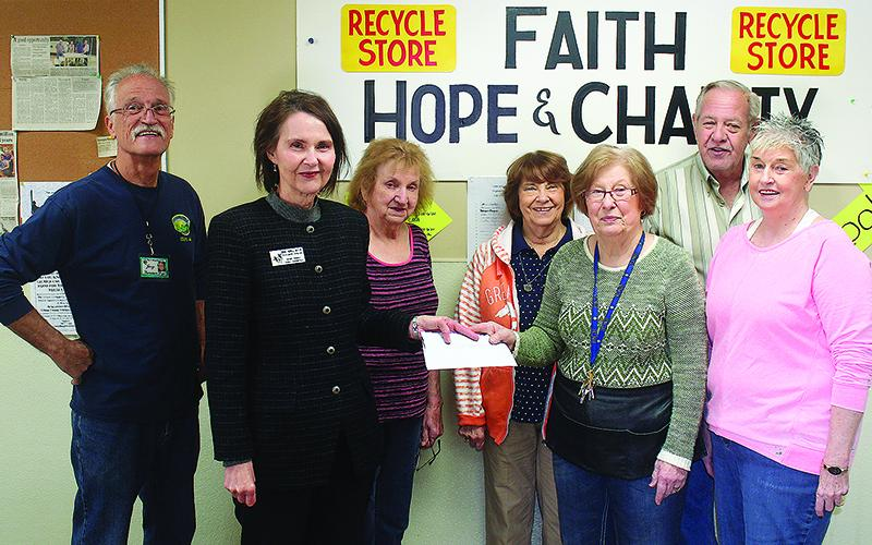 Gilmer Family Connection Director Merle Howell Naylor, second from left, accepts a donation check for the nonprofit's Christmas Campaign from Faith, Hope and Charity Recycle Store representatives Jerry Below, Rita Odom, Bonnie Greene, Marcia Phillips, John Hamrick and Edith Warren.