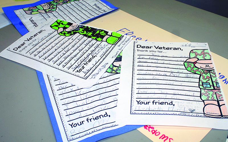 On display at last year's Veterans Day lunch at the Ellijay Lions Club were several examples of the various writing and art projects done by students in local schools to honor local military men and women each year.