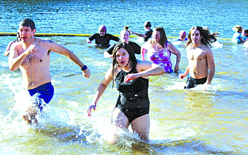 Participants hustle to get out of the 52-degree lake.