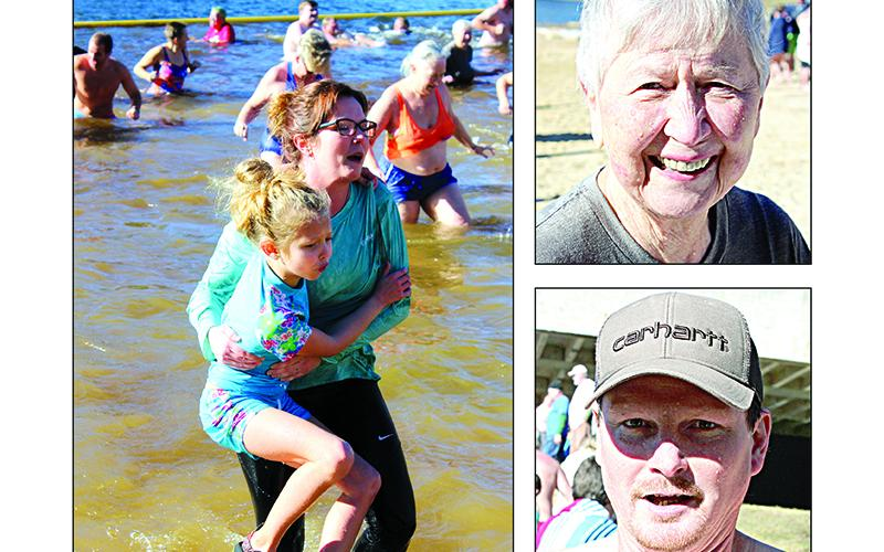 Right, Julie Deloney, of Ellijay and John Boyd, of Chatsworth.Left, a mother tries to hold her daughter above the water as both exit the lake.