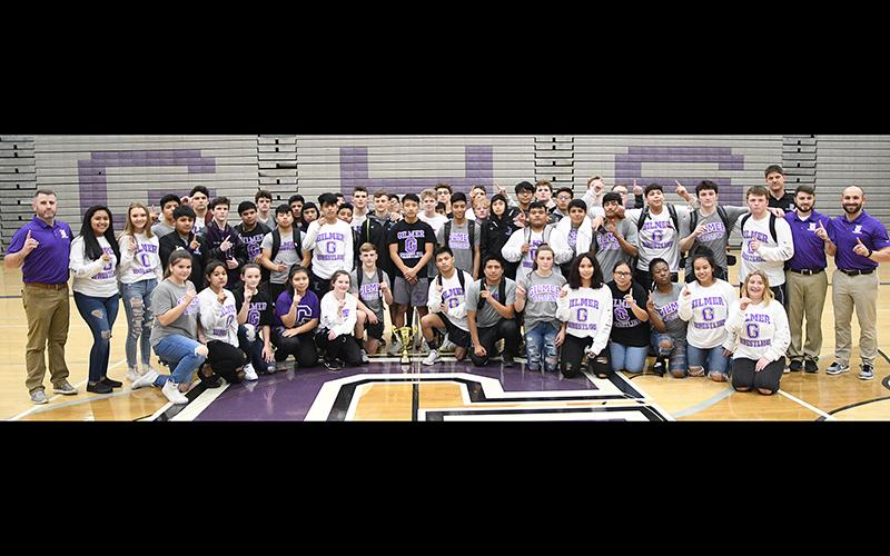 Above are Gilmer High School wrestlers, coaches and managers after the Bobcats' region duals wrestling championship last Saturday. GHS defeated Northwest Whitfield in the finals, 30-25.