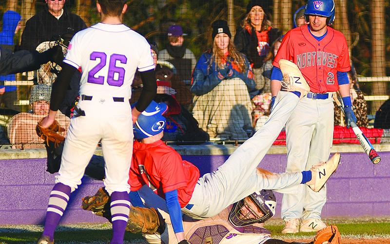 A Northwest Whitfield base runner safely scores following a wild pitch as Gilmer catcher Gabe Wolfson applies the tag.