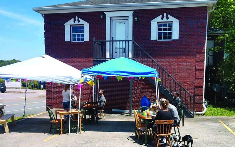 An outdoor dining area has been used to accommodate Cornerstone Cafe customers after the downtown Ellijay restaurant recently reopened.
