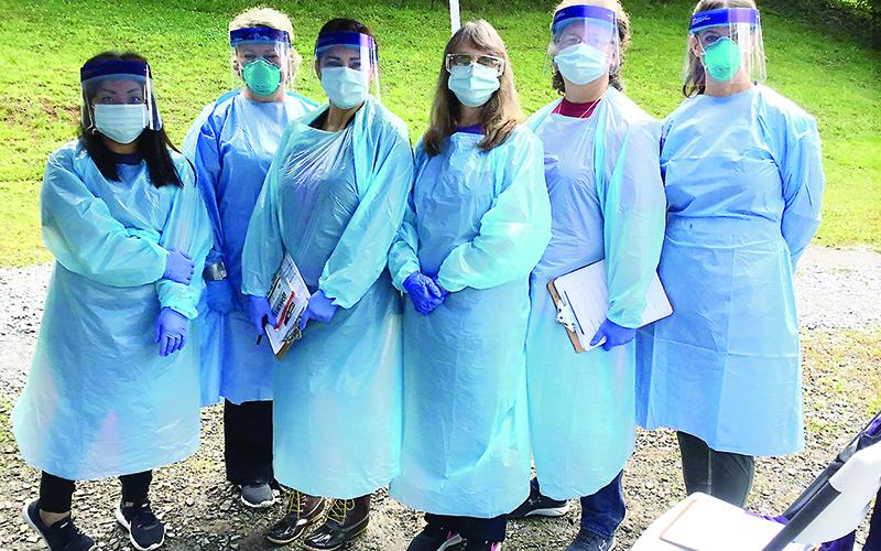 Public health staff members from the Gilmer County Health Department are pictured in protective gear worn while working at the local COVID-19 testing site. Pictured, from left, are Nohemi Reynoso, Leigh Ann Dover, Irene Rosales, Trina Matthews, Monica Ledford and Krystal Sumner.