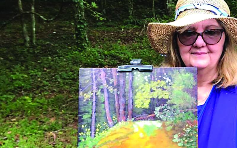 "Jan Dappen shows a ""quick draw"" painting she made the recent Plein Air: Art in the Mountains event."