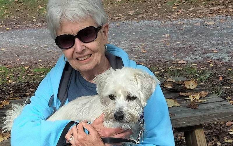 Lynn Robey, a volunteer with Homeward Bound Pet Rescue, enjoys time outdoors with Oscar, a former resident of the Homeward Bound kennel who she adopted.